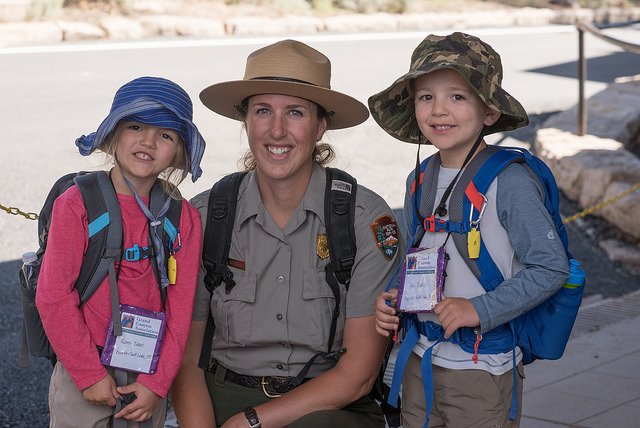 two children pose with a NPS ranger