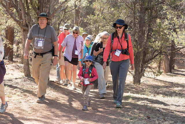 supporters walk along the rim trail at Grand Canyon