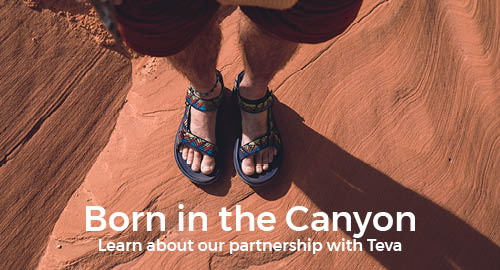 View of mens feet wearing Teva sandals with Born in the Canyon text over the photo