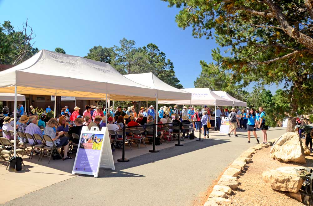 A crowd of people under tents at the Grand Canyon Conservancy's Celebration of Art event
